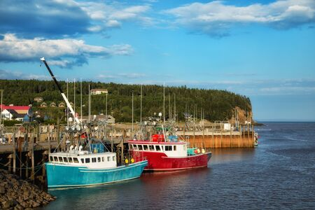 Fishing boats in the bay of Fundy in New Brunswick Stock Photo