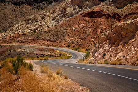 nevada: Waving road into Valley of fire in Nevada with mountains in background