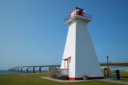Port Borden Range Front Lighthouse with the confederation bridge in background in Prince Edward island in Canada Stock Photo