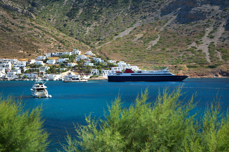 Yatchs and ships in Kamares village with turquoise water and mountain in Sifnos In Greece