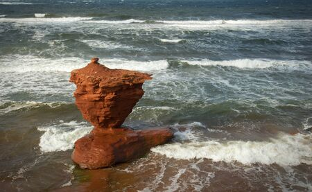 The cup of tea at thunder cove beach during high tide in Prince Edward island in Canada