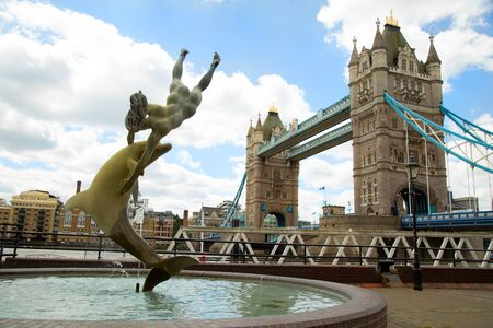 LONDON-UK, june 7 2017: The Boy with a Dolphin sculpture is widely considered to be one of Londons most graceful public works of art with tower bridge in background