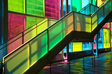 MONTREAL, CANADA - September 14, 2017: Colourful glass panels and stairs in Palais des congres de Montreal (Montreal Convention and Conference Centre)  Montreal, Canada Editorial