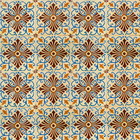 Photograph of traditional portuguese tiles in blue, brown and orange