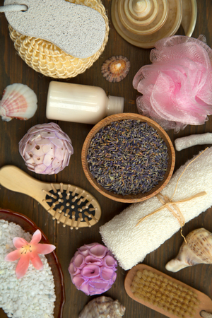 Top view of various spa products and treatment on a wooden table Фото со стока