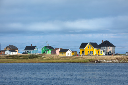 Beautiful houses on the shore of Havre Aubert in magdalen island in Quebec, Canada Imagens