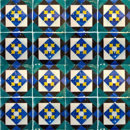 Photograph of traditional portuguese tiles in green, black and blue