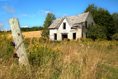 Deserted house in a meadow in Quebec in Canada