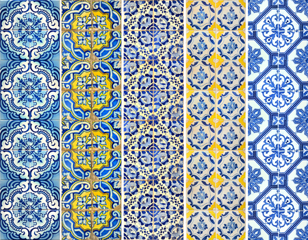 Photograph of traditional portuguese tiles with different pattern in blue and yellow