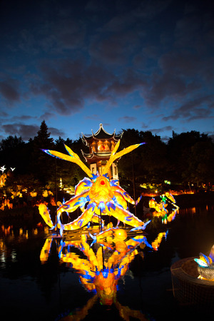 MONTREAL, CANADA- SEPT 8 2018:  Botanical garden exhibit in Montreal Glittering lanterns of various shapes illuminate the Chinese Garden and the eyes of thousands of visitors who come to enjoy the magical spectacle.