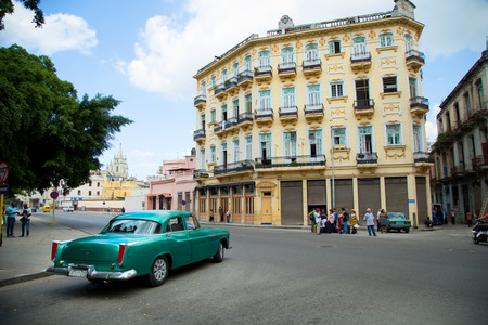 HAVANA-CUBA- DEC 4, 2018:  A classic American green vintage car in old Havana in Cuba.  These car owners can truly take pride in having survived an era of no spare car parts and protecting their beauties. Editorial
