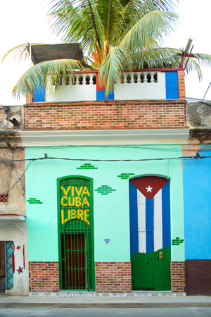 Colorful doors in Havana in Cuba.   One with Cuba Libre and the other with the cuban flag draw on it. Editorial