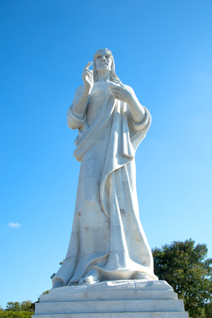 HAVANA-CUBA- DEC 9, 2018:  Large sculpture representing Jesus of Nazareth on a hilltop overlooking the bay in Havana, Cuba made by the Cuban sculptor Jilma Madera, who won the commission for it in 1953