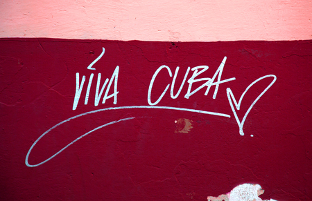 Viva Cuba inscription on a red and pink wall