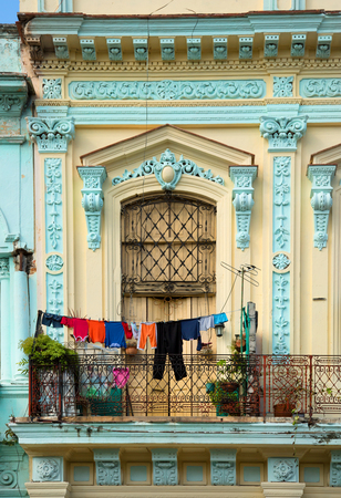 White clothes floating on a clothesline in Centro havana in Cuba