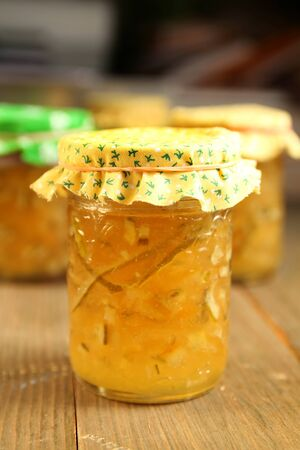 Citrus homemade marmalade with yellow material on top