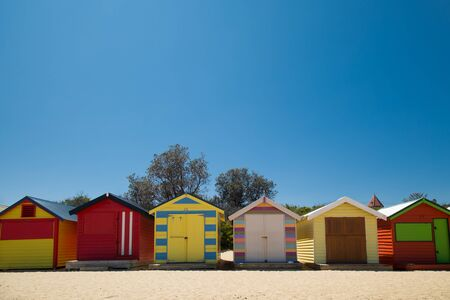 Traditional and colourful little beach house in a row at Brighton beach in Victoria, Australia