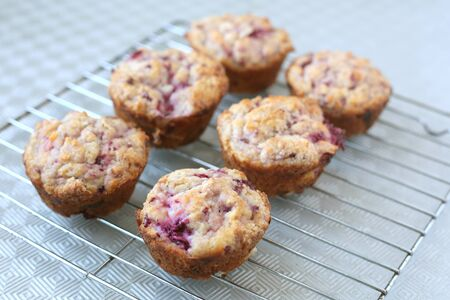 Warm and fresh handmade strawberry muffins on a grill