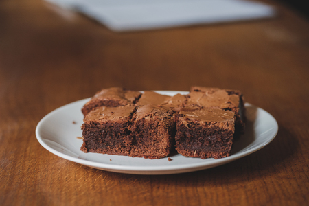 Homemade delicious brownie slices in white plate and warm tone Stock Photo