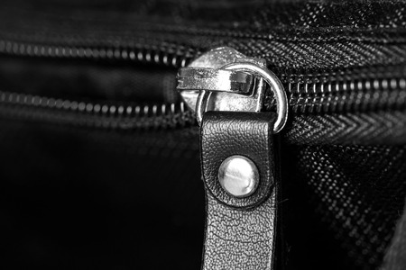 security gap: Metal zipper on black synthetic fabric