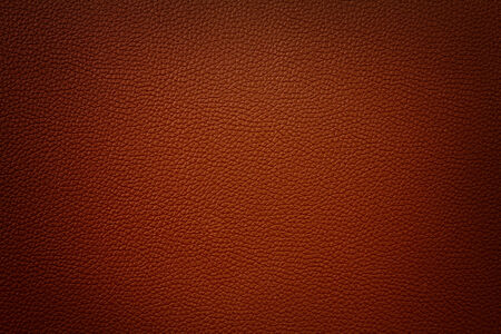 dark red red synthetic leather texture background with vignette  Reklamní fotografie