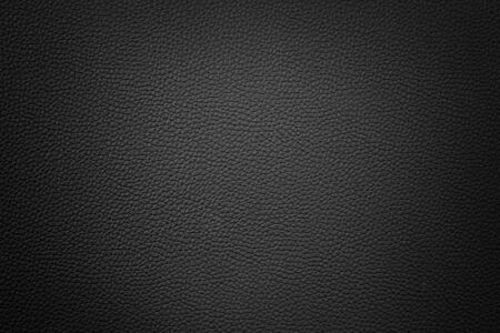 black color synthetic leather texture background with vignette