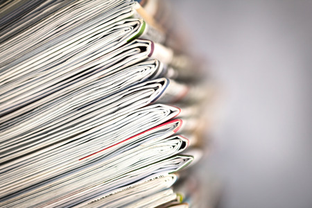 closeup stack of newspaper photo