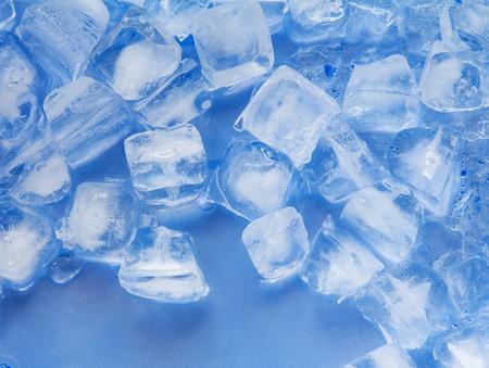 Ice cube on plastic blue tray Zdjęcie Seryjne - 31642070