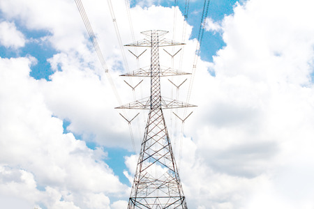 electric grid: Electric transmission line tower with cloudy sky Stock Photo