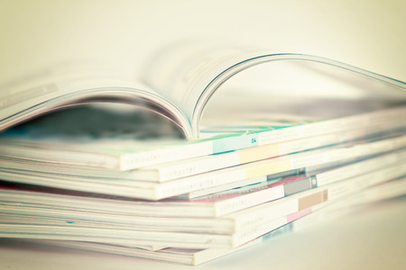 selective soft focus of open and Stacking of magazines Reklamní fotografie