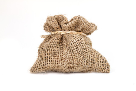 Brown small burlap bag with rope on white background photo