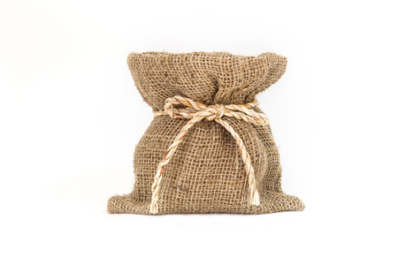 Brown small burlap bag with bow rope on white background photo