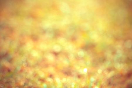 lighting background: Abstract blured gloden bokeh lighting background