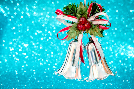 silver bells: christmas silver bells gift on blur cool blue bokeh light background with left space