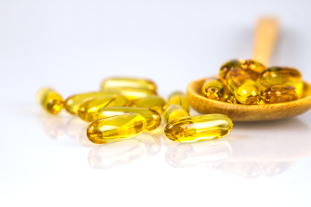 Closeup the yellow soft gelatin supplement fish oil capsule Stock Photo