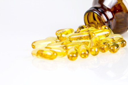 primrose oil: Closeup the yellow soft gelatin supplement fish oil capsule Stock Photo
