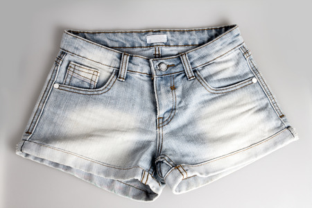 jeanswear: light blue short jean pants Stock Photo