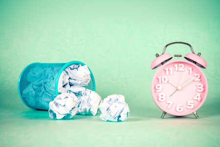 scrunch: retro and vintage style of Old fashioned the alarm clock and clumpled peper waste  idea Stock Photo