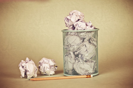 trash container: retro and vintage style of  clumpled peper waste  idea Stock Photo