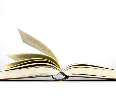 The opened book on white background photo