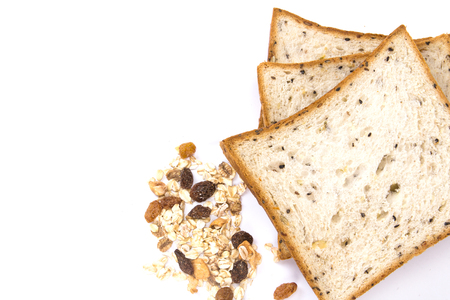 roasted sesame: the cereal and black sesame bread with whole grain cereal flakes which mixed warming cinnamon , red skin apple , golden raisins and roasted hazelnuts on white background
