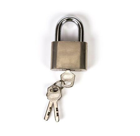 the Mealic padlock with the key on white background photo
