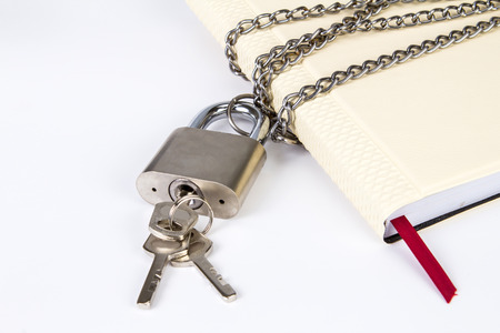 A padlock protects the book in a concept on protect the secret information photo