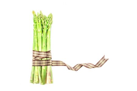 bind: the Asparagus bind with brown ribbon on white background and text space