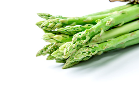 bind: the Asparagus bind with brown ribbon on white background Stock Photo