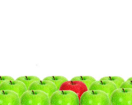 individualism: red apple place on white background among green apple with water droplet as frame border  unique
