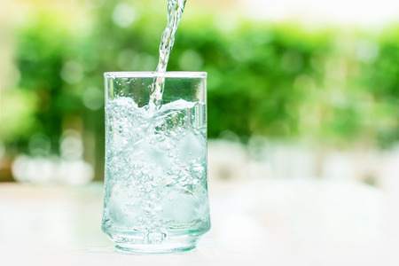 glass of water: a glass of cool water with some water flow down motion