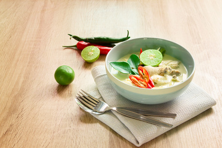 meat soup: Spicy creamy coconut soup with chicken  Thai food called Tom Kha Gai on wooden table