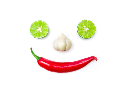 smile face: lime  chili and garlic arrange as smiling face Stock Photo