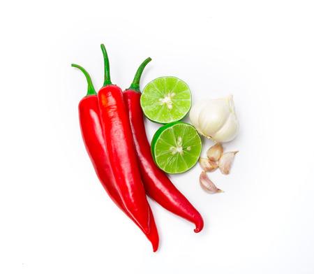 the red chili , garlic and lime lemon arrange on white background Zdjęcie Seryjne